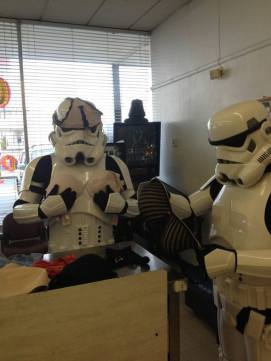 #5 - IMAGE: A stormtrooper at a laundry mat folding clothes.